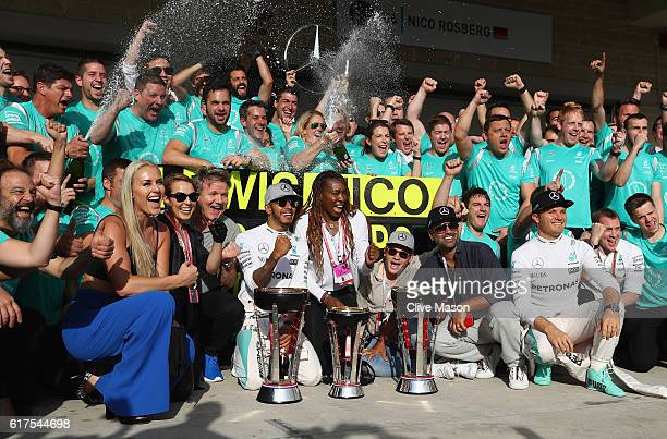 Lewis Hamilton of Great Britain and Mercedes GP celebrates his win with Nico Rosberg of Germany and Mercedes GP skier Lindsey Vonn chef Gordon Ramsey...