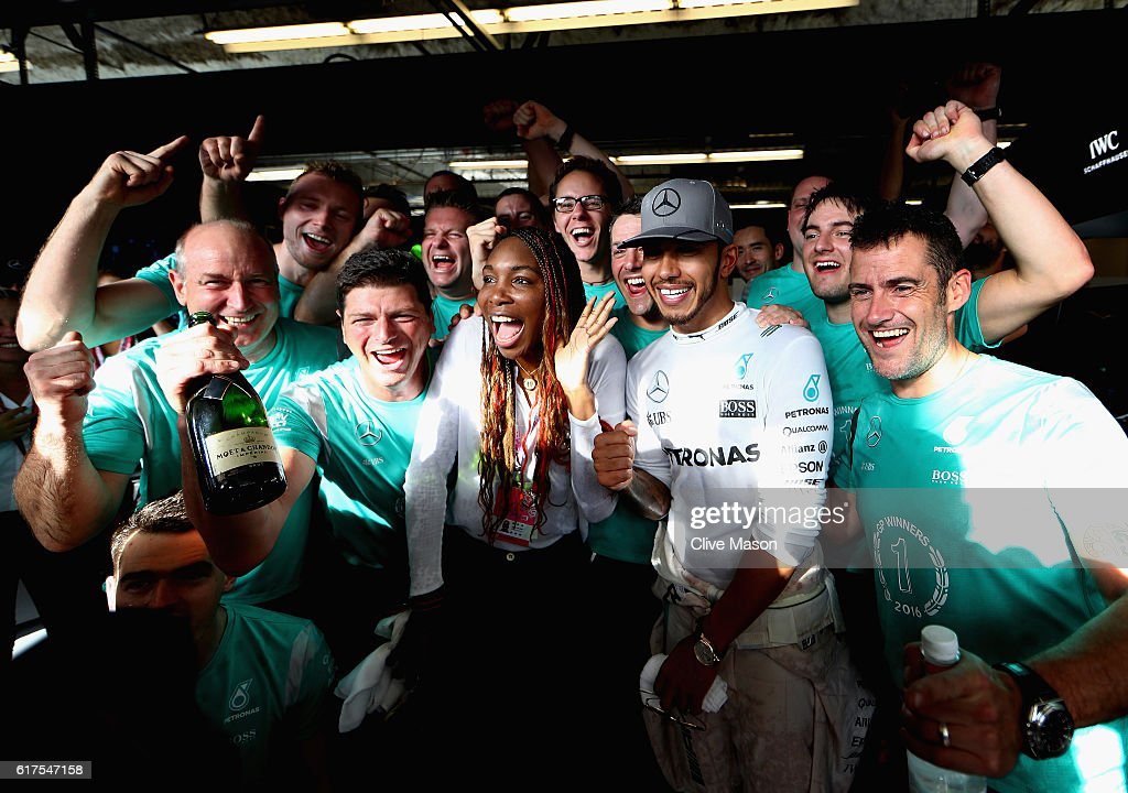 Lewis Hamilton of Great Britain and Mercedes GP celebrates his win with tennis superstar Venus Williams and his team during the United States Formula One Grand Prix at Circuit of The Americas on October 23, 2016 in Austin, United States.