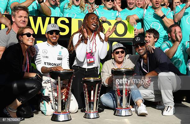 Lewis Hamilton of Great Britain and Mercedes GP celebrates his win with tennis superstar Venus Williams and his team during the United States Formula...