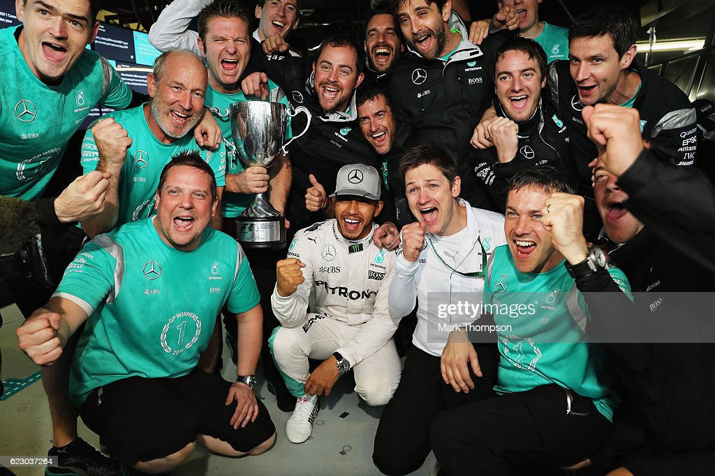 Lewis Hamilton of Great Britain and Mercedes GP celebrates his win with his team during the Formula One Grand Prix of Brazil at Autodromo Jose Carlos Pace on November 13, 2016 in Sao Paulo, Brazil.
