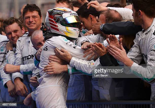 Lewis Hamilton of Great Britain and Mercedes GP celebrates his victory with his team following the Chinese Formula One Grand Prix at the Shanghai...
