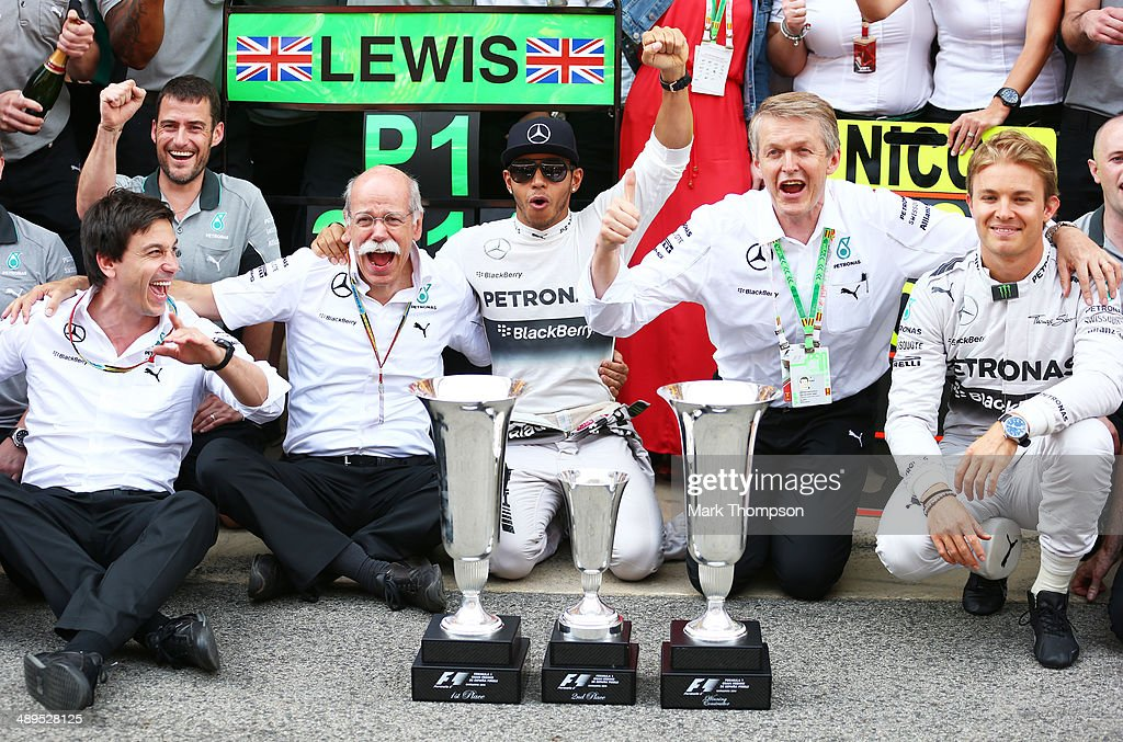 Lewis Hamilton of Great Britain and Mercedes GP celebrates his victory with team-mate Nico Rosberg of Germany and Mercedes GP, Mercedes GP Executive Director Toto Wolff (L) and the rest of the team after the Spanish Formula One Grand Prix at Circuit de Catalunya on May 11, 2014 in Montmelo, Spain.