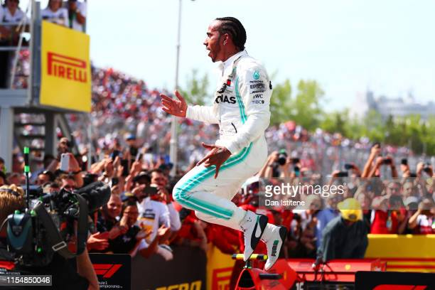 Lewis Hamilton of Great Britain and Mercedes GP celebrates in parc ferme after winning the F1 Grand Prix of Canada at Circuit Gilles Villeneuve on...