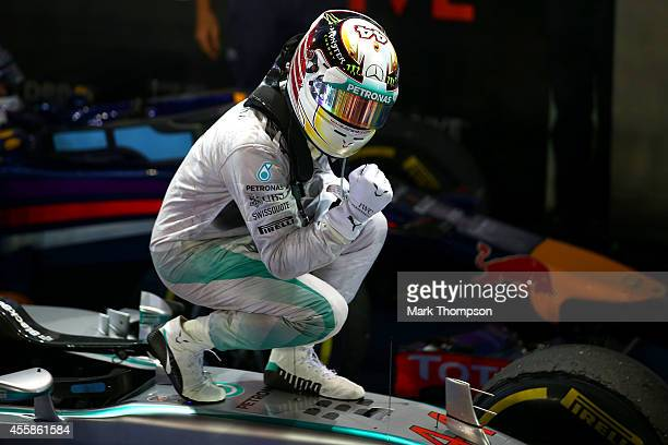 Lewis Hamilton of Great Britain and Mercedes GP celebrates in Parc Ferme after winning the Singapore Formula One Grand Prix at Marina Bay Street...
