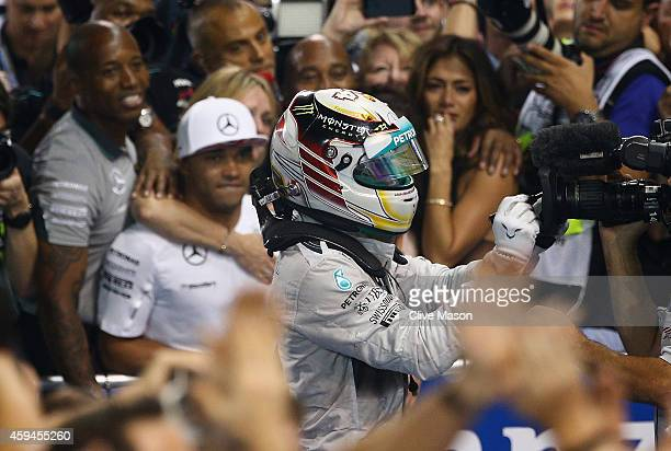 Lewis Hamilton of Great Britain and Mercedes GP celebrates in Parc Ferme after winning the World Championship and the Abu Dhabi Formula One Grand...