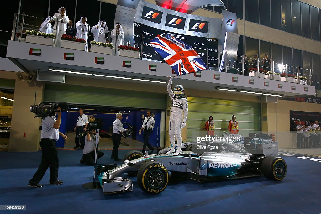 Lewis Hamilton of Great Britain and Mercedes GP celebrates in Parc Ferme after winning the World Championship and the Abu Dhabi Formula One Grand Prix at Yas Marina Circuit on November 23, 2014 in Abu Dhabi, United Arab Emirates.