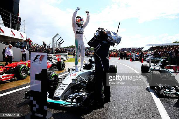 Lewis Hamilton of Great Britain and Mercedes GP celebrates in Parc Ferme after winning the Formula One Grand Prix of Great Britain at Silverstone...