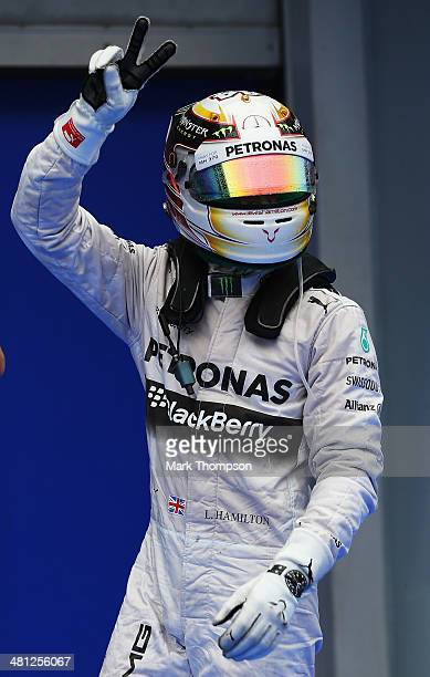 Lewis Hamilton of Great Britain and Mercedes GP celebrates in parc ferme after finishing first during qualifying for the Malaysia Formula One Grand...
