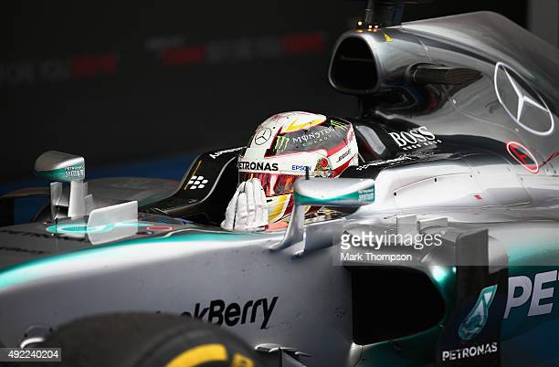 Lewis Hamilton of Great Britain and Mercedes GP celebrates in Parc Ferme after winning the Formula One Grand Prix of Russia at Sochi Autodrom on...