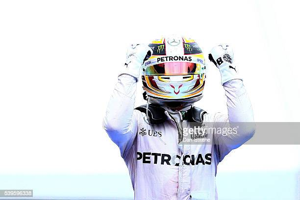 Lewis Hamilton of Great Britain and Mercedes GP celebrates in parc ferme after winning the Canadian Formula One Grand Prix at Circuit Gilles...
