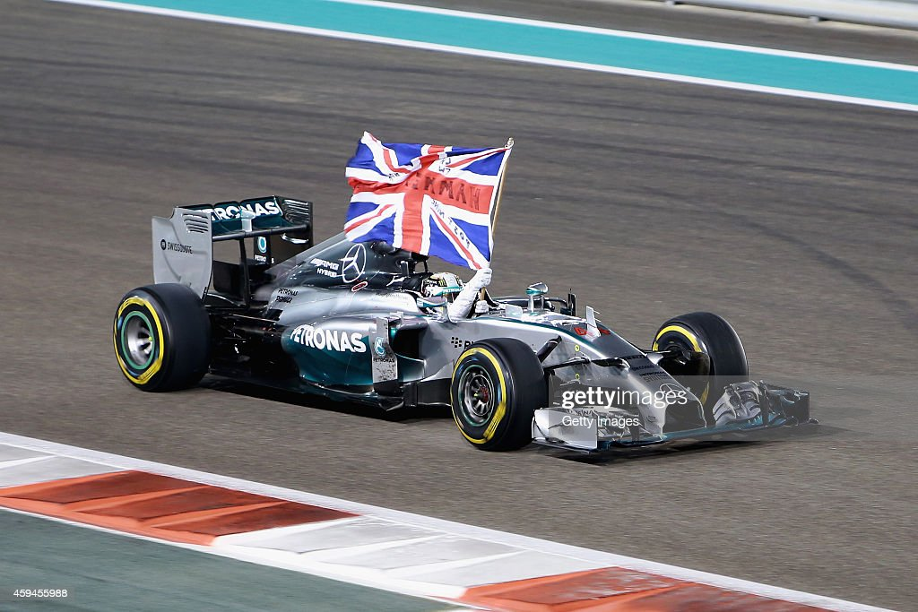 Lewis Hamilton of Great Britain and Mercedes GP celebrates in the car after winning the World Championship and the Abu Dhabi Formula One Grand Prix at Yas Marina Circuit on November 23, 2014 in Abu Dhabi, United Arab Emirates.
