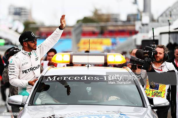 Lewis Hamilton of Great Britain and Mercedes GP celebrates in the Pitlane after getting pole position during qualifying for the Australian Formula...