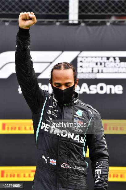 Lewis Hamilton of Great Britain and Mercedes GP celebrates on the podium after winning the Formula One Grand Prix of Styria at Red Bull Ring on July...