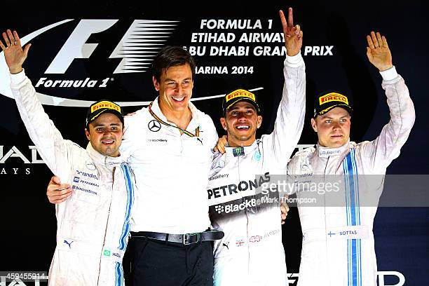Lewis Hamilton of Great Britain and Mercedes GP celebrates on the podium next to Mercedes GP Executive Director Toto Wolff Felipe Massa of Brazil and...