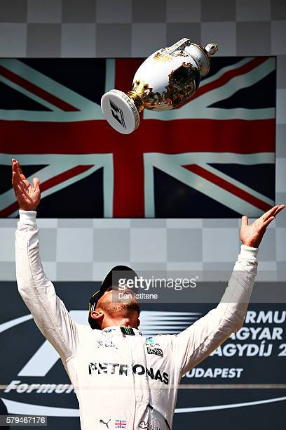 Lewis Hamilton of Great Britain and Mercedes GP celebrates on the podium during the Formula One Grand Prix of Hungary at Hungaroring on July 24 2016...