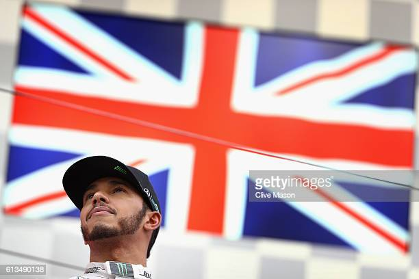 Lewis Hamilton of Great Britain and Mercedes GP celebrates on the podium after finishing third during the Formula One Grand Prix of Japan at Suzuka...