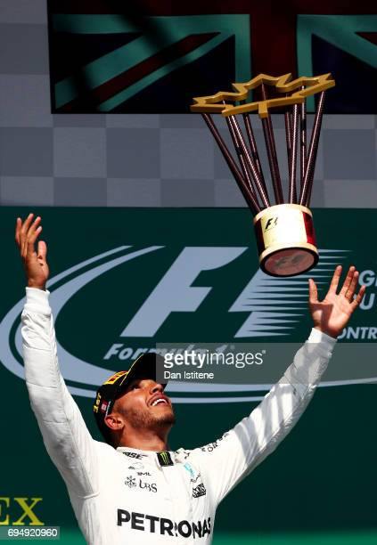 Lewis Hamilton of Great Britain and Mercedes GP celebrates on the podium after winning the Canadian Formula One Grand Prix at Circuit Gilles...
