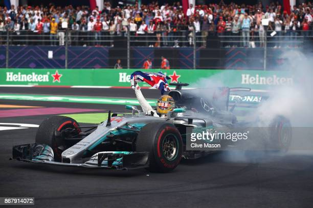 Lewis Hamilton of Great Britain and Mercedes GP celebrates on track after winning his fourth F1 World Drivers Championship during the Formula One...