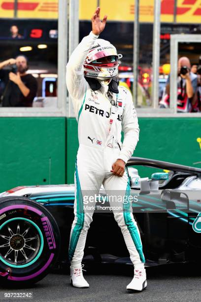 Lewis Hamilton of Great Britain and Mercedes GP celebrates on track after qualifying in pole position during qualifying for the Australian Formula...