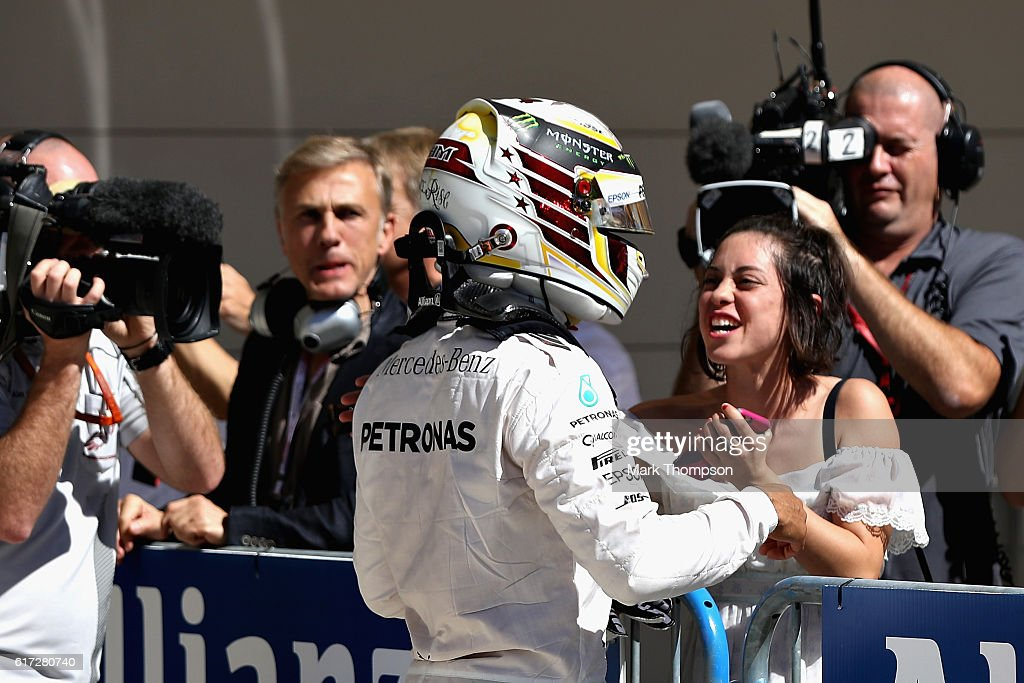 Lewis Hamilton of Great Britain and Mercedes GP celebrates qualifying in pole position with actor Rosa Salazer in parc ferme during qualifying for the United States Formula One Grand Prix at Circuit of The Americas on October 22, 2016 in Austin, United States.