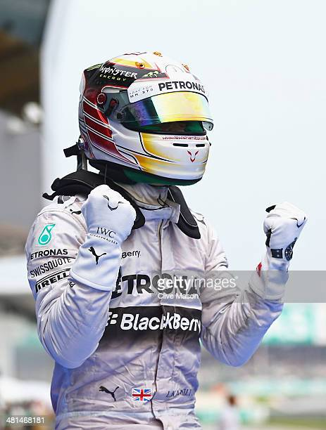 Lewis Hamilton of Great Britain and Mercedes GP celebrates victory after the Malaysia Formula One Grand Prix at the Sepang Circuit on March 30 2014...