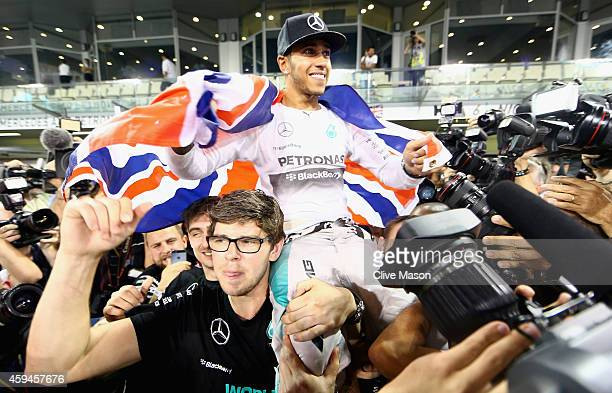 Lewis Hamilton of Great Britain and Mercedes GP celebrates with his team after winning the World Championship after the Abu Dhabi Formula One Grand...