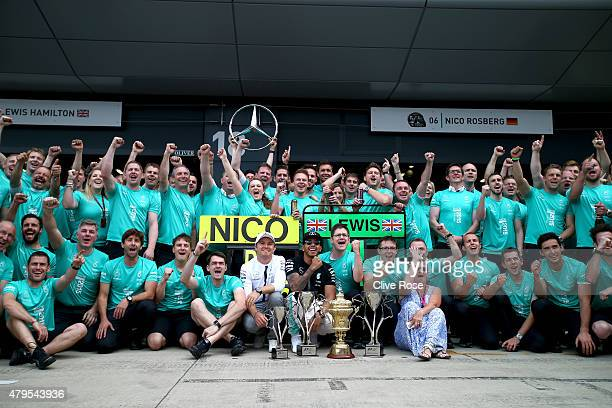 Lewis Hamilton of Great Britain and Mercedes GP celebrates with his team including Nico Rosberg of Germany and Mercedes GP and his mother Carmen...