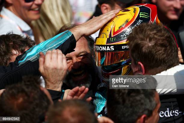 Lewis Hamilton of Great Britain and Mercedes GP celebrates with his team in Parc Ferme after winning the Canadian Formula One Grand Prix at Circuit...