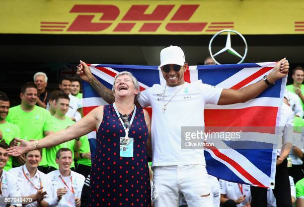 Lewis Hamilton of Great Britain and Mercedes GP celebrates with his mother Carmen Larbalestier after winning his fourth F1 World Drivers Championship...