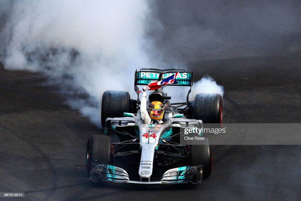 Lewis Hamilton of Great Britain and Mercedes GP celebrates with donuts on track after winning his fourth F1 World Drivers Championship during the Formula One Grand Prix of Mexico at Autodromo Hermanos Rodriguez on October 29, 2017 in Mexico City, Mexico.