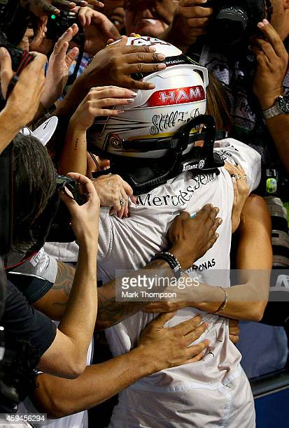 Lewis Hamilton of Great Britain and Mercedes GP celebrates with Nicole Scherzinger Nicolas Hamilton Anthony Hamilton and Linda Hamilton in Parc Ferme...