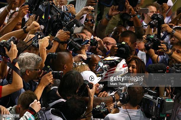Lewis Hamilton of Great Britain and Mercedes GP celebrates with Nicole Scherzinger Nicolas Hamilton Anthony Hamilton and Linda Hamilton in Parc Ferme...