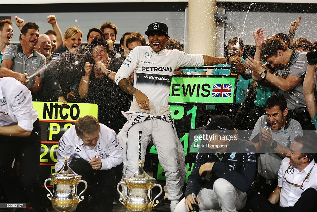 Lewis Hamilton of Great Britain and Mercedes GP celebrates with team mates in the pitlane after winning the Bahrain Formula One Grand Prix at the Bahrain International Circuit on April 6, 2014 in Sakhir, Bahrain.