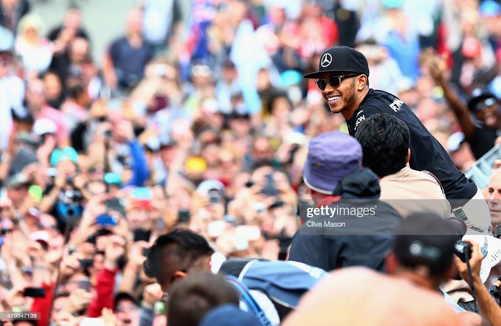 Lewis Hamilton of Great Britain and Mercedes GP celebrates with the fans after winning the Formula One Grand Prix of Great Britain at Silverstone Circuit on July 5, 2015 in Northampton, England.