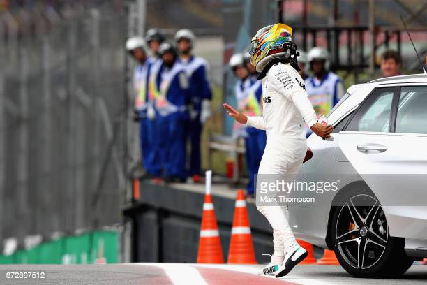 Lewis Hamilton of Great Britain and Mercedes GP climbs from the Medical Car after crashing during qualifying for the Formula One Grand Prix of Brazil...