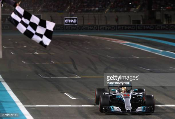 Lewis Hamilton of Great Britain and Mercedes GP crosses the line during the Abu Dhabi Formula One Grand Prix at Yas Marina Circuit on November 26...