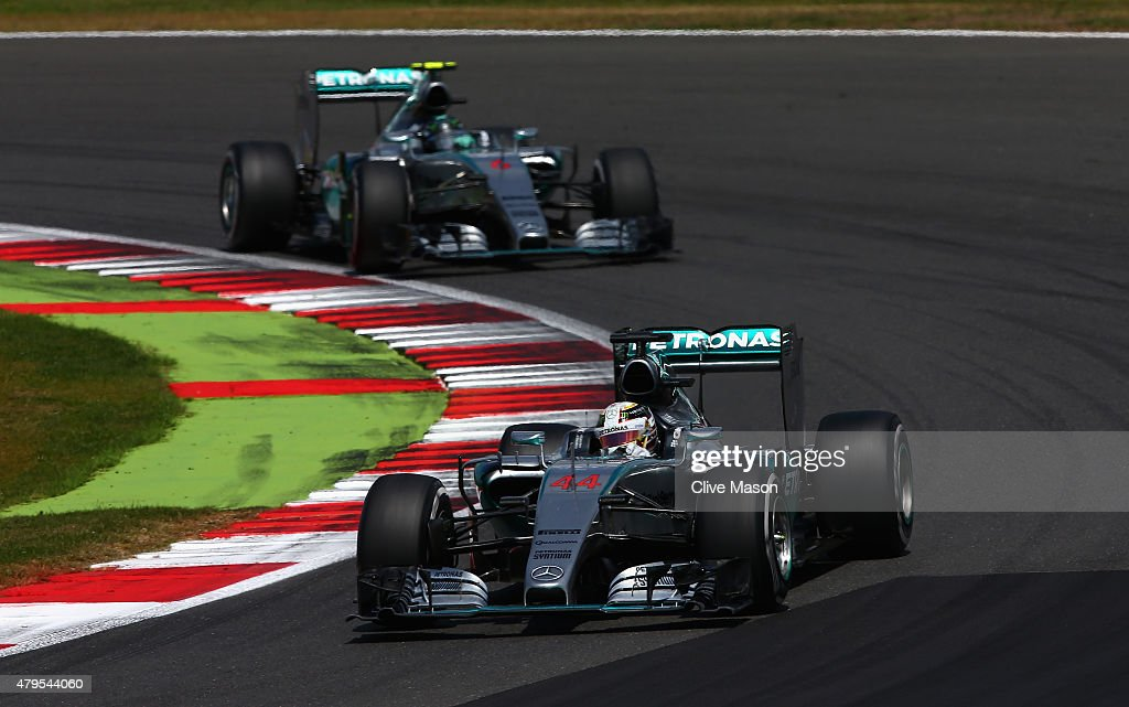 Lewis Hamilton of Great Britain and Mercedes GP drives ahead of Nico Rosberg of Germany and Mercedes GP during the Formula One Grand Prix of Great Britain at Silverstone Circuit on July 5, 2015 in Northampton, England.