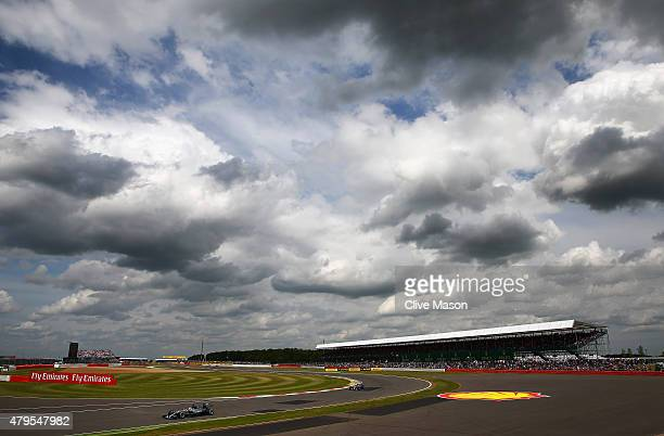 Lewis Hamilton of Great Britain and Mercedes GP drives ahead of Nico Rosberg of Germany and Mercedes GP during the Formula One Grand Prix of Great...