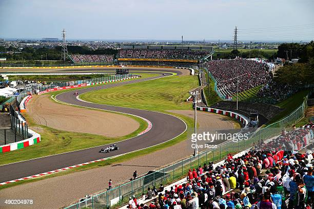 Lewis Hamilton of Great Britain and Mercedes GP drives ahead of Sebastian Vettel of Germany and Ferrari Valtteri Bottas of Finland and Williams and...