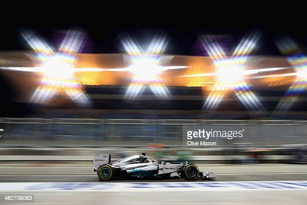 Lewis Hamilton of Great Britain and Mercedes GP drives down the pitlane during practice for the Bahrain Formula One Grand Prix at the Bahrain...