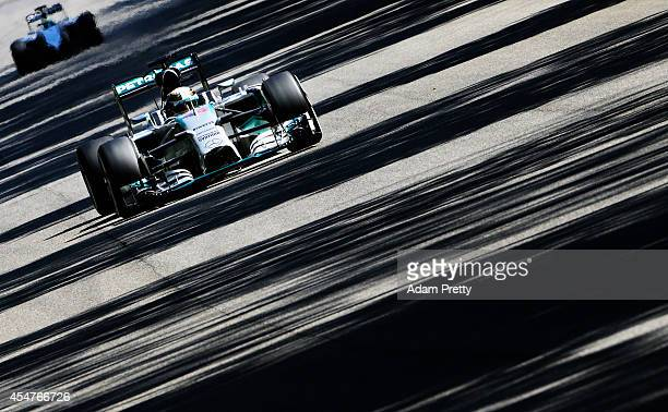 Lewis Hamilton of Great Britain and Mercedes GP drives during Practice ahead of the F1 Grand Prix of Italy at Autodromo di Monza on September 6 2014...