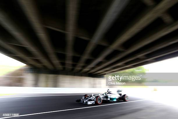 Lewis Hamilton of Great Britain and Mercedes GP drives during final practice for the Japanese Formula One Grand Prix at Suzuka Circuit on October 4,...