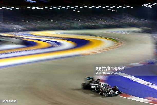 Lewis Hamilton of Great Britain and Mercedes GP drives during the Singapore Formula One Grand Prix at Marina Bay Street Circuit on September 21, 2014...