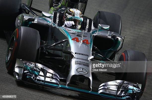 Lewis Hamilton of Great Britain and Mercedes GP drives during the Singapore Formula One Grand Prix at Marina Bay Street Circuit on September 21 2014...