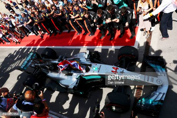 Lewis Hamilton of Great Britain and Mercedes GP drives in to Parc Ferme after winning the Canadian Formula One Grand Prix at Circuit Gilles...