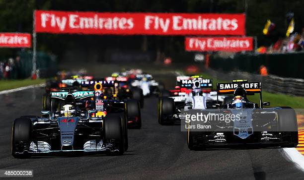 Lewis Hamilton of Great Britain and Mercedes GP drives next to Sergio Perez of Mexico and Force India during the Formula One Grand Prix of Belgium at...