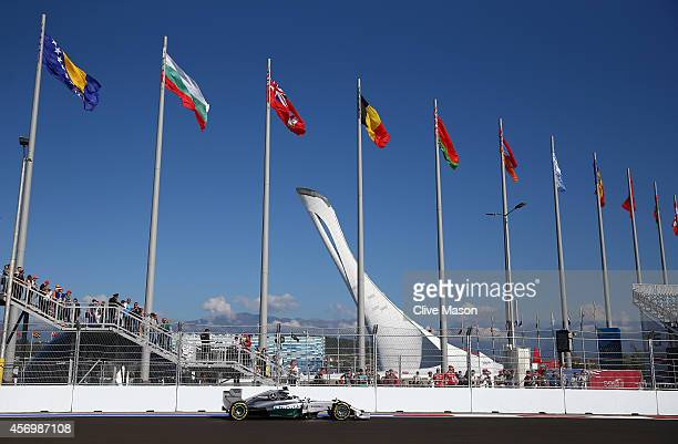 Lewis Hamilton of Great Britain and Mercedes GP drives past the Olympic Cauldron during practice ahead of the Russian Formula One Grand Prix at Sochi...