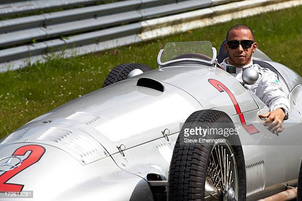 Lewis Hamilton of Great Britain and Mercedes GP drives the 1938 Mercedes W154 around the historic Nordschleife circuit during previews to the German...