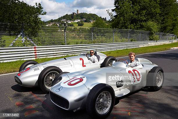 Lewis Hamilton of Great Britain and Mercedes GP drives the 1938 Mercedes W154 and Nico Rosberg of Germany and Mercedes GP drives the 1954 Mercedes...