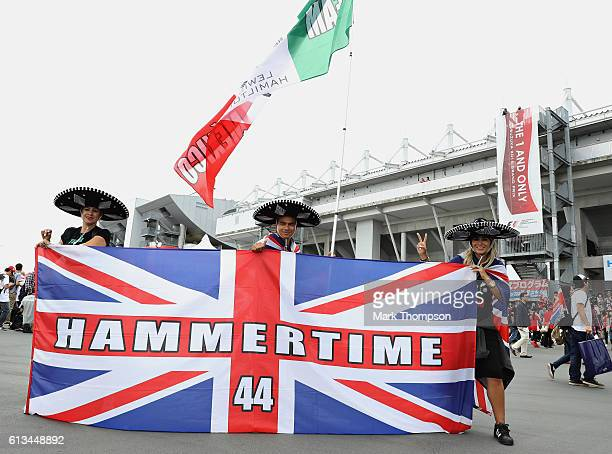 Lewis Hamilton of Great Britain and Mercedes GP fans from Mexico in the fan zone at the circuit before the Formula One Grand Prix of Japan at Suzuka...